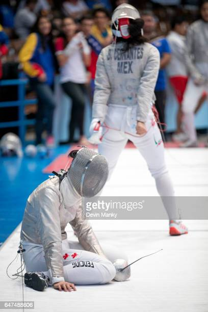 Matina Pun of Canada sits in dejection after losing a match to Natalia Botello of Mexico during Cadet Women's Sabre competition at the Cadet and...