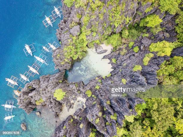 matinloc island hidden beach el nido philippines - el nido stock pictures, royalty-free photos & images