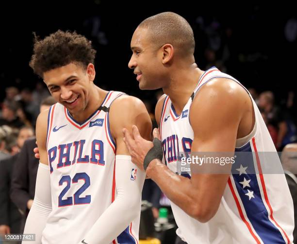 Matisse Thybulle and Al Horford of the Philadelphia 76ers celebrate the win over Brooklyn Nets at Barclays Center on January 20, 2020 in New York...