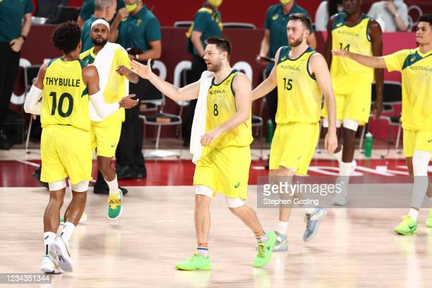 Matisse Thybulle hi-fives Patty Mills and Matthew Dellavedova of the Australia Men's National Team during the game against the Germany Men's National...