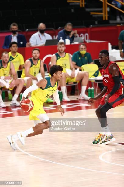 Matisse Thybulle of the Australia Men's National Team dribbles the ball during the game against the Germany Men's National Team during the 2020 Tokyo...