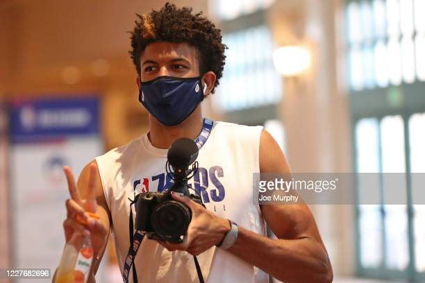 Matisse Thybulle of the Philadelphia 76ers arrives with his camera during practice as part of the NBA Restart 2020 on July 18, 2020 in Orlando,...