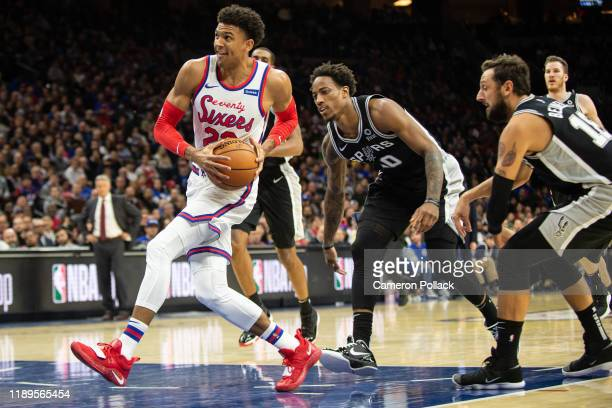 Matisse Thybulle of the Philadelphia 76ers drives to the basket past DeMar DeRozan of the San Antonio Spurs during the fourth quarter of a game at...