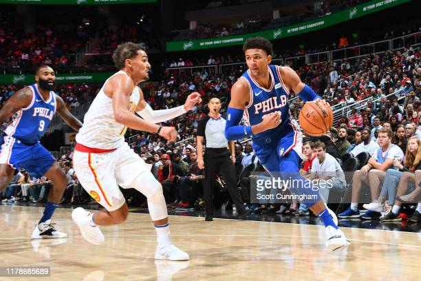 Matisse Thybulle of the Philadelphia 76ers handles the ball against Trae Young of the Atlanta Hawks on October 28, 2019 at State Farm Arena in...