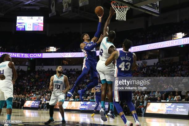 Matisse Thybulle of the Philadelphia 76ers shoots the ball against the Charlotte Hornets during the preseason on October 11 2019 at Lawrence Joel...