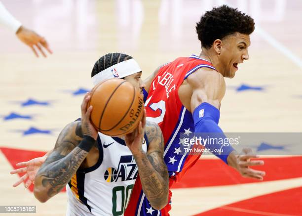 Matisse Thybulle of the Philadelphia 76ers tries to steal the ball from Jordan Clarkson of the Utah Jazz during the second quarter at Wells Fargo...