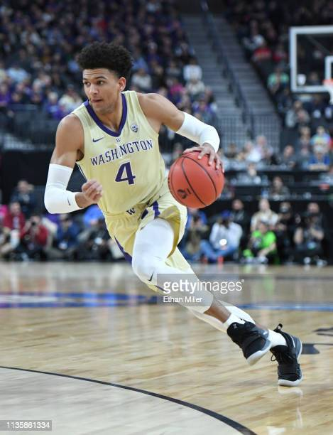 Matisse Thybulle of the Washington Huskies brings the ball up the court against the USC Trojans during a quarterfinal game of the Pac12 basketball...