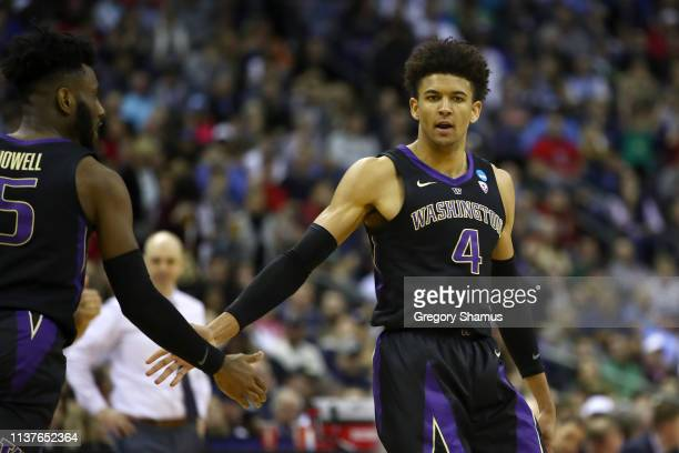 Matisse Thybulle of the Washington Huskies celebrates with Jaylen Nowell as they take on the Utah State Aggies during the second half of the game in...