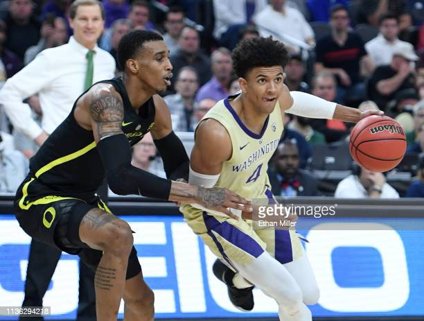 Matisse Thybulle of the Washington Huskies drives against Kenny Wooten of the Oregon Ducks during the championship game of the Pac12 basketball...
