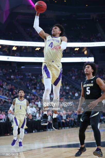 Matisse Thybulle of the Washington Huskies dunks the ball in the 1st half against the Colorado Buffaloes during a semifinal game of the Pac12...