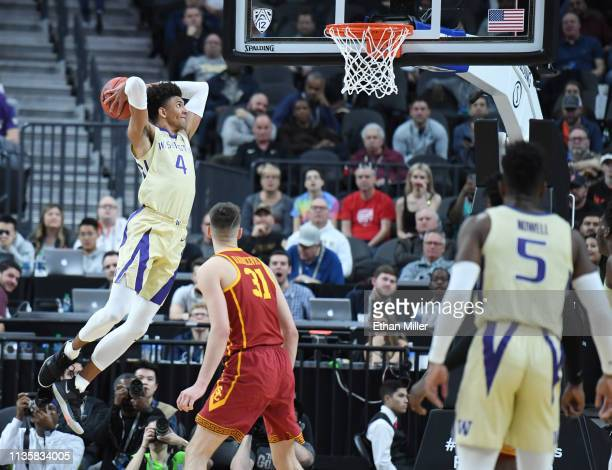 Matisse Thybulle of the Washington Huskies goes in for a dunk against the USC Trojans during a quarterfinal game of the Pac12 basketball tournament...