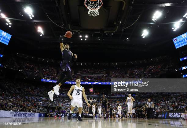Matisse Thybulle of the Washington Huskies goes up to the basket against Abel Porter of the Utah State Aggies during the first half of the game in...