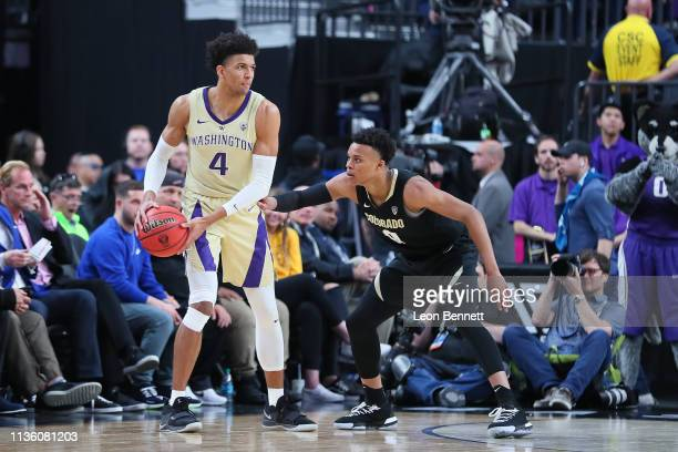 Matisse Thybulle of the Washington Huskies handles the ball against Shane Gatling of the Colorado Buffaloes during a semifinal game of the Pac12...
