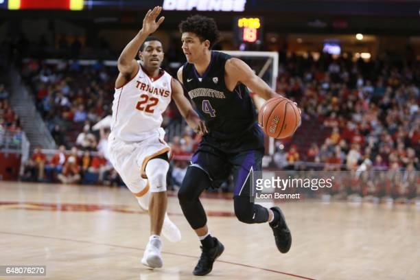 Matisse Thybulle of the Washington Huskies handles the ball against De'Anthony Melton of the USC Trojans during a Pac12 conference college basketball...