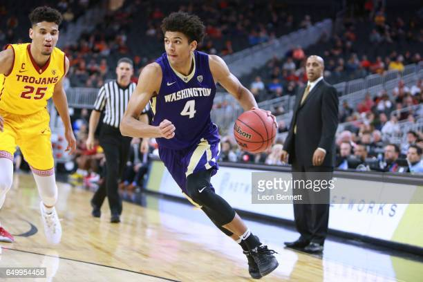 Matisse Thybulle of the Washington Huskies handles the ball against Bennie Boatwright of the USC Trojans during a firstround game of the Pac12...