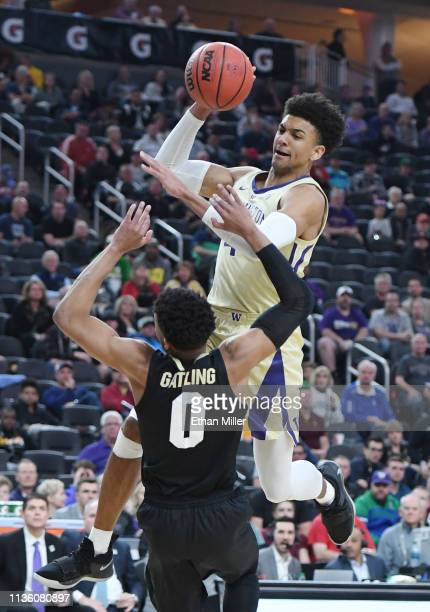 Matisse Thybulle of the Washington Huskies is fouled as he drives to the basket against Shane Gatling of the Colorado Buffaloes during a semifinal...
