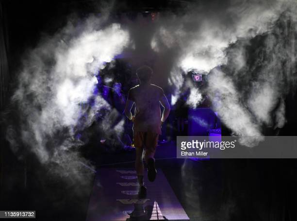 Matisse Thybulle of the Washington Huskies is introduced before a quarterfinal game of the Pac12 basketball tournament against the USC Trojans at...