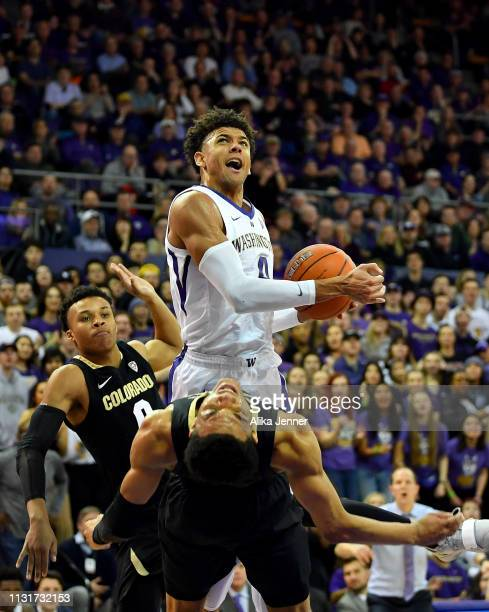 Matisse Thybulle of the Washington Huskies knocks over Tyler Bey of the Colorado Buffaloes at Hec Edmundson Pavilion on February 23 2019 in Seattle...