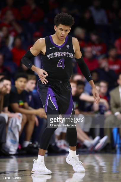Matisse Thybulle of the Washington Huskies reacts after hititng a threepoint shot against the Arizona Wildcats during the first half of the NCAAB...