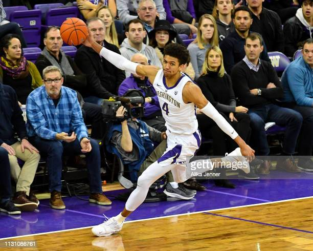 Matisse Thybulle of the Washington Huskies saves a ball and moves toward the basket against the Utah Utes at Hec Edmundson Pavilion on February 20...