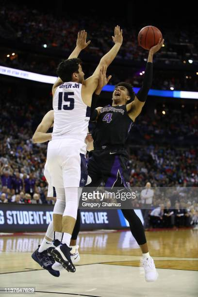 Matisse Thybulle of the Washington Huskies shoots against Abel Porter of the Utah State Aggies during the second half of the game in the first round...