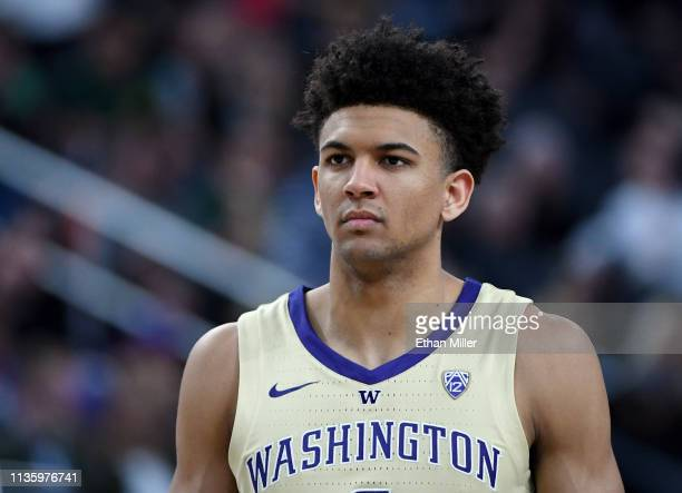 Matisse Thybulle of the Washington Huskies walks on the court during a quarterfinal game of the Pac12 basketball tournament against the USC Trojans...