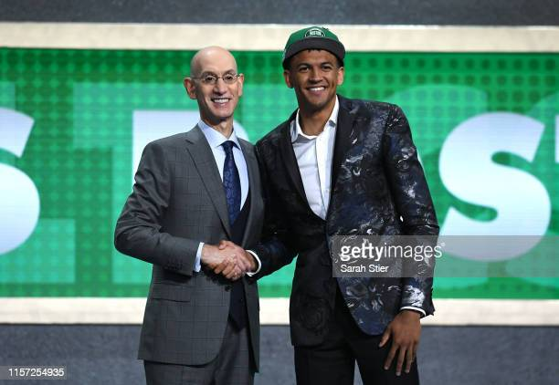 Matisse Thybulle poses with NBA Commissioner Adam Silver after being drafted with the 20th overall pick by the Boston Celtics during the 2019 NBA...