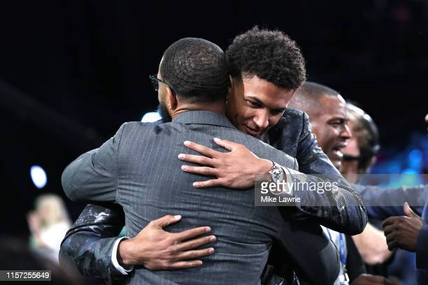 Matisse Thybulle reacts after being drafted with the 20th overall pick by the Boston Celtics during the 2019 NBA Draft at the Barclays Center on June...