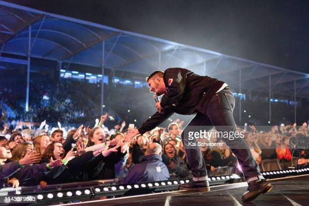 Matiu Walters of Six60 greets fans during the You Are Us/Aroha Nui Concert at Christchurch Stadium on April 17 2019 in Christchurch New Zealand The...