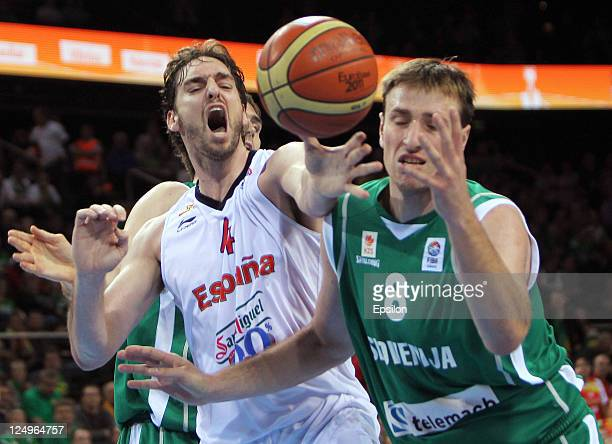 Matjaz Smodis of Slovenia and Pau Gasol of Spain fight for the ball during the EuroBasket 2011 Quarter Final match between Slovenia and Spain at...