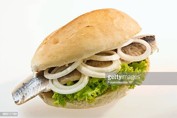 Matjes herring roll with lettuce and onions, elevated view, close-up