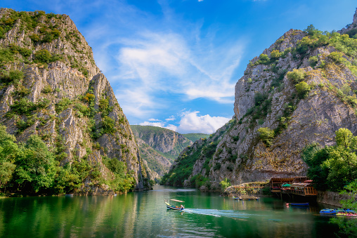 Matka canyon with boat in lake 1051413790