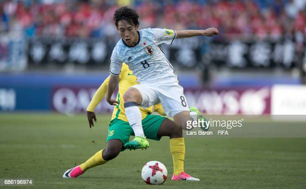 Matlala Makgalwa of South Africa challenges Koji Miyoshi of Japan during the FIFA U20 World Cup Korea Republic 2017 group D match between South...