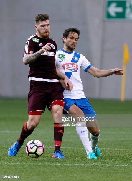 Mato Grgic of MTK Budapest duels for the ball with Martin Adam of Vasas FC during the Hungarian OTP Bank Liga match between MTK Budapest and Vasas FC...