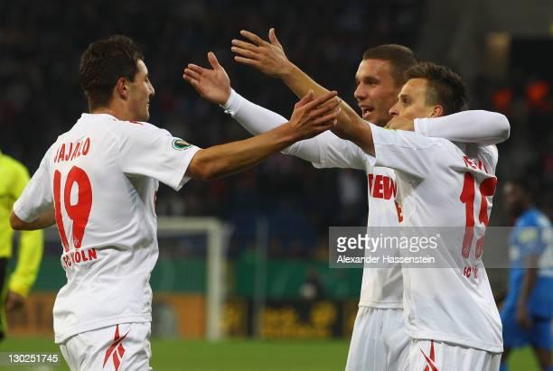 Mato Jajalo of Koeln celebrates scoing the opening goal with his team mates Slawomir Peszko and Lukas Podolski during the DFB Pokal second round...