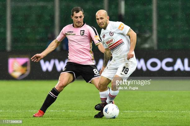 Mato Jajalo of Palermo and Cristian Galano of Foggia compete for the ball during the Serie B match between US Citta di Palermo and Foggia at Stadio...