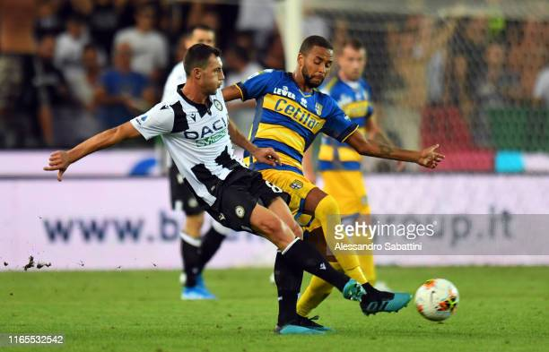 Mato Jajalo of Udinese Calcio competes for the ball with Hernani of Parma Calcio during the Serie A match between Udinese Calcio and Parma Calcio at...