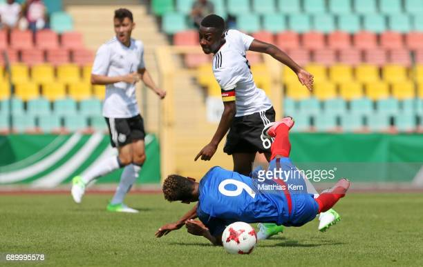 Matondo Merveille Papela of Germany battles for the ball with Willem Geubbels of France during the U16 international friendly match between Germany...