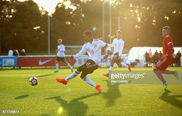 Matondo Merveille Papela of Germany U17 scores the opening goal during the International match between Russia U17 and Germany U17 at St Georges Park...