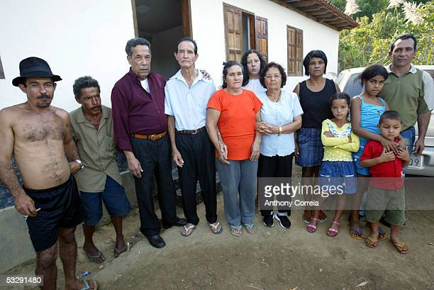Matozinhos Otoni da Silva and his wife Maria Otoni de Menezes stand with relatives and friends outside their family home July 26 2005 in Gonzaga...