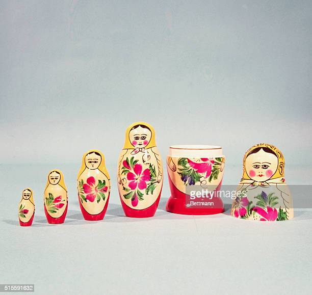 Matreshka a famous Russian toy consists of five little wooden figures that all fit inside one another of a gaily dressed peasant woman