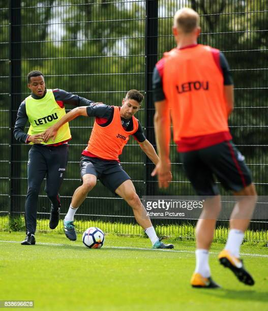 Matrin Olsson challenges Federico Fernandez during the Swansea City Training and Press Conference at The Fairwood Training Ground on August 24 2017...