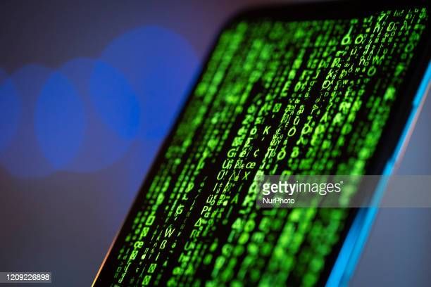 A matrix style graphic is seen on the screen of an iPhone 11 Pro Max in this illustration photo in Warsaw Poland on April 4 2020