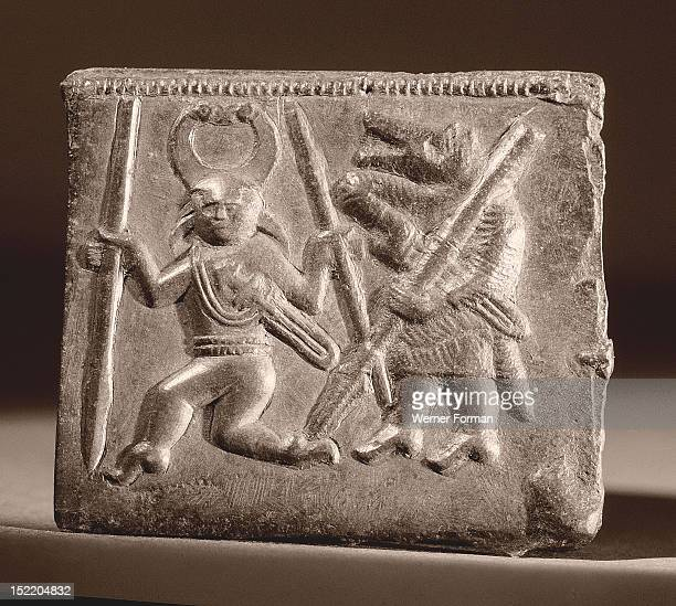 Matrix used in the manufacture of helmet plaques,The dancing figure wears a helmet whose horns terminate in birds heads; his companion wears the mask...