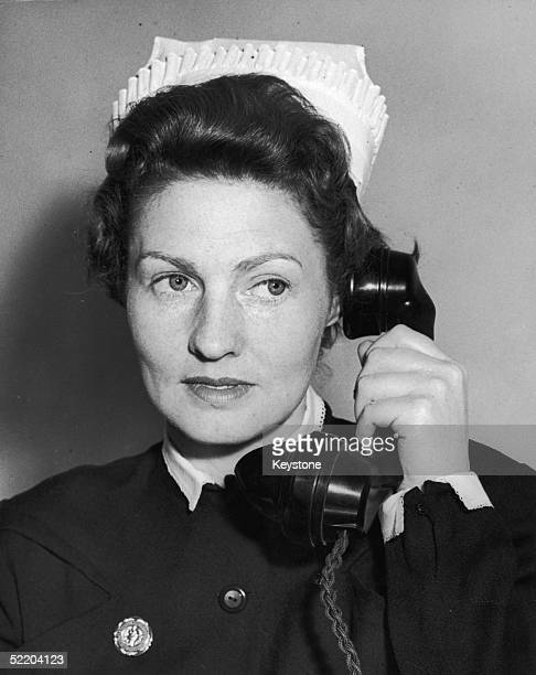 Matron Dorothy Woods takes a call at the New Victoria Hospital KingstononThames 28th May 1958 The Hospital is the first voluntary Hospital to be...