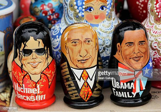 Matryoshka dolls in the likeness of late singer Michael Jackson Russian Prime Minister Vladimir Putin and US President Barack Obama stand on display...
