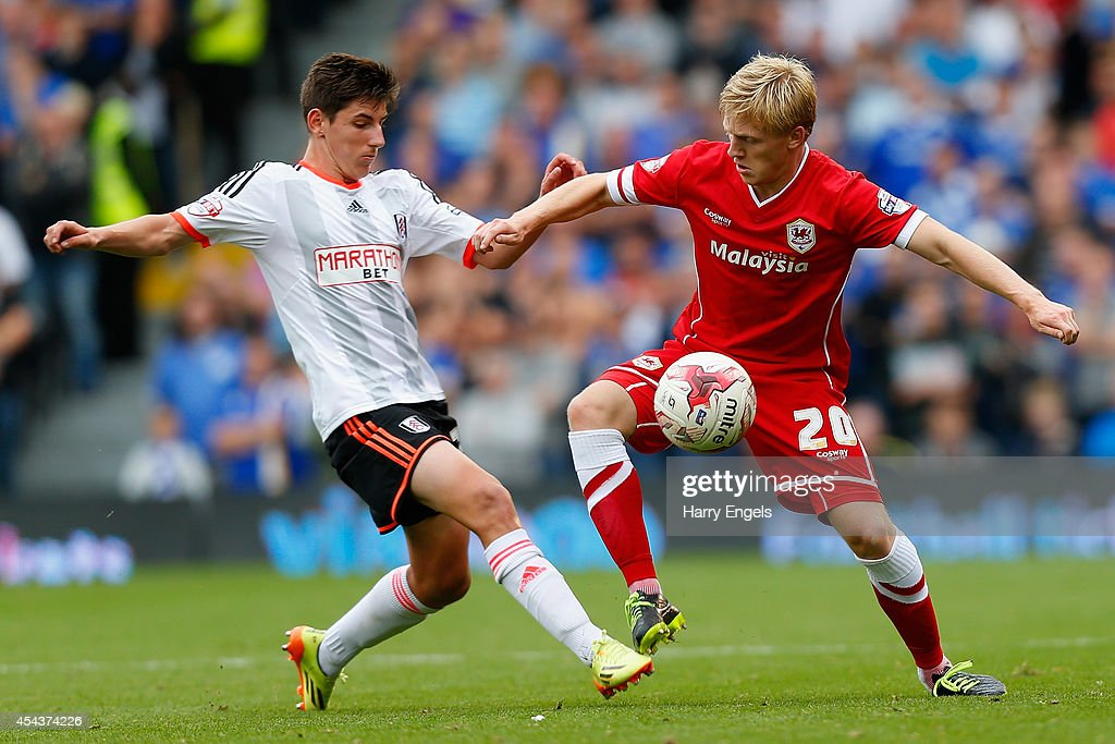 Mats Daehli of Cardiff City is challenged by Emerson Hyndman of Fulham during the Sky Bet Championship match between Fulham and Cardiff City at Craven Cottage on August 30, 2014 in London, England.