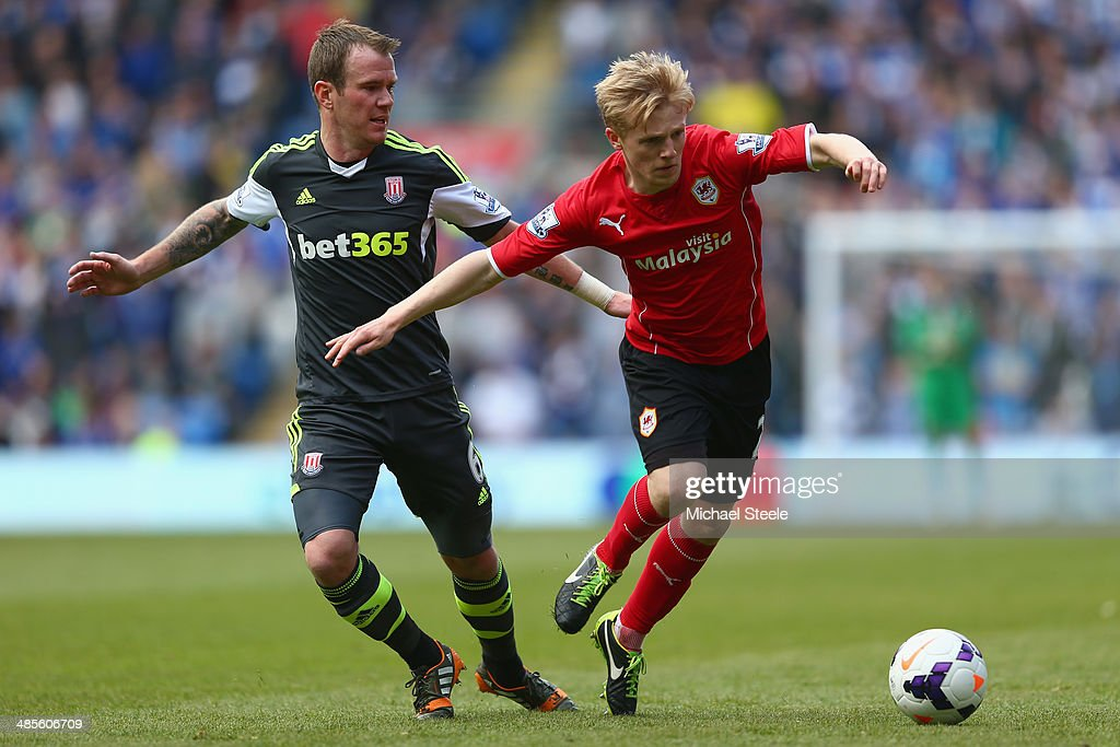 Mats Daehli (R) of Cardiff City is tracked by Glenn Whelan (L) of Stoke City during the Barclays Premier League match between Cardiff City and Stoke City at the Cardiff City Stadium on April 19, 2014 in Cardiff, Wales.