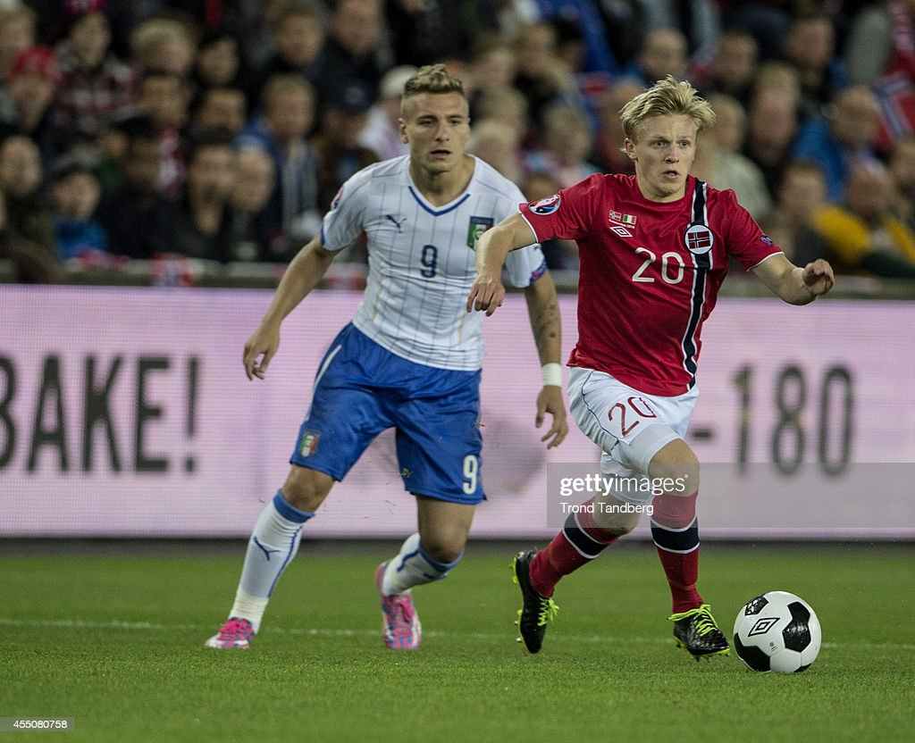 Mats Daehli of Norway and Ciro Immobile of Italy battle during the UEFA EURO 2016 qualifier match between Norway and Italy at Ullevaal Stadion on September 9, 2014 in Oslo, Norway.