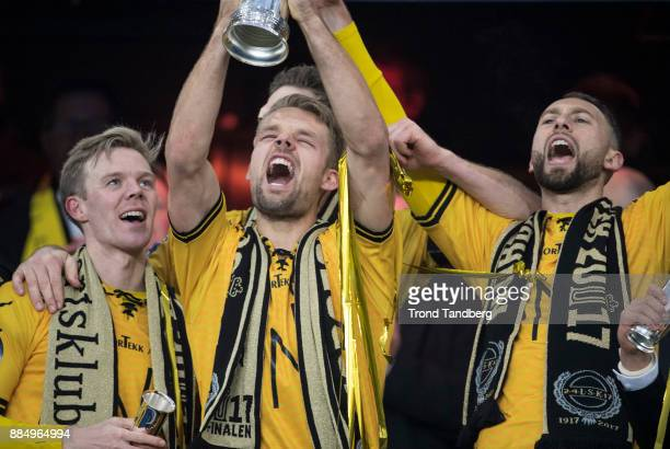 Mats Haakenstad Stefan Antonijevic Erling Knudtzon of Lillestrom celebrates with Trophy after victory between Sarpsborg 08 v Lillestrom at Ullevaal...